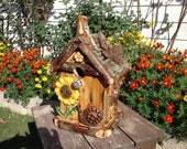 Rustic Bird house featuring sunflower,snail,butterflies, and frog.