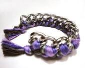 Woven bracelet in grey and purple colors