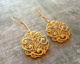Ancient Motif Earrings - Gold Tone