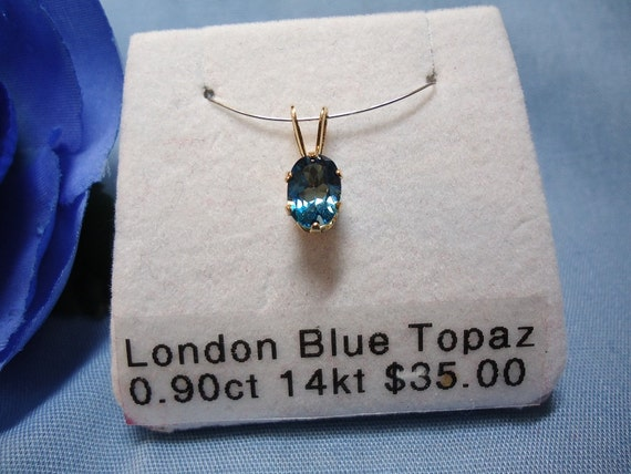 Oval London Blue Topaz in 14 kt Yellow Gold