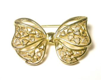 Delightful Gold Tone Bow Brooch
