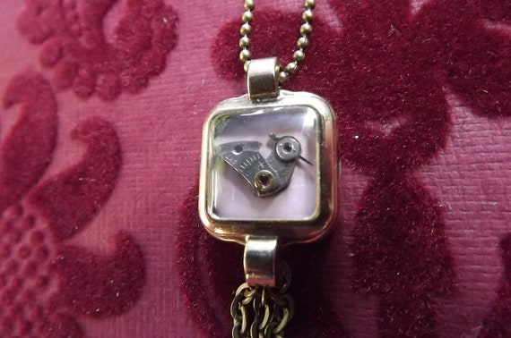 Vintage Bird in watch case