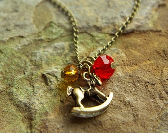 Bronze Fine Chain Necklace with Bronze Rocking Horse Charm and Amber and Red Crystal Bead Charms - 19 inches