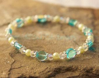 Silver Blue Stretch Bead Stack Bracelet in Shimmery Iridescent Blue, Light Yellow, Silver