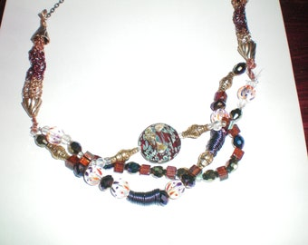 Look at me necklace, 3 strands necklace with beautiful metal spirals, very original and haut de gamme, you will be noticed for sure