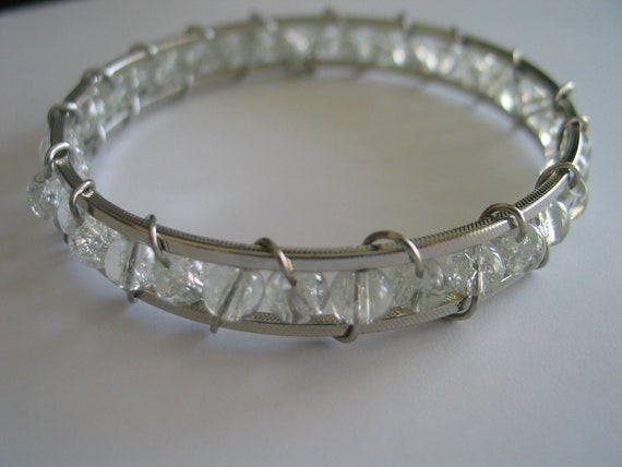Wire wrapped bangle silver colored bracelet with clear white frosted beads