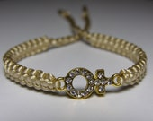 Venus symbol bracelet in golden metal with rhinestones