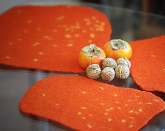 Placemats in bright orange with dots