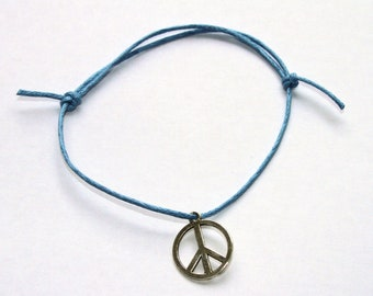 peace silver charm on waxed cotton cord adjustable friendship bracelet