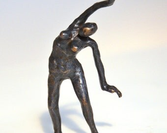 Bronze sculpture having a stretch to the left
