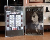Foreigner Lou Gramm Solo album cassettes and a perm for your Friday alone time