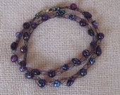"Purple wire with 31 purple beads. 22"" length"