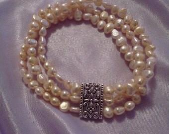 fresh water pearls three strain bracelet