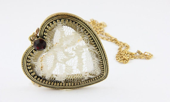Gold plated heart shaped pendant and necklace with white lace and a red stone