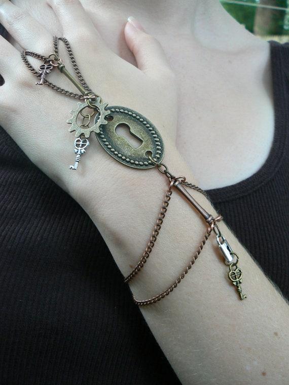 steampunk slave bracelet keyhole gear keys padlocks and chains in steampunk goth fantasy boho and style