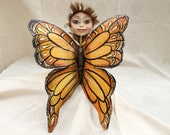 A Recycled Fairy Doll.  Butterfly Decoration.  An art professional piece.  A paper mache sculpture.