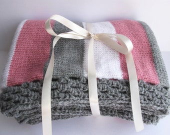 Grey, white and  rose pink knitted baby blanket