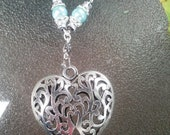 Swirl Heart Pendant made with Sterling Silver Wire,and complimenting Royal Sea Blue Beads