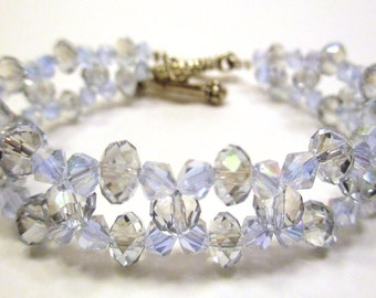Beaded bracelet, Crystal bracelet with light blue crystals on fishing line cord with a toggle clasp