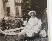 Original Antique Black and White Photograph of Child Fishing in Boat of Flowers