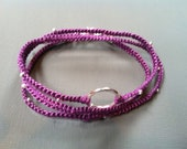 Wrapped purple floss bracelet with silver hardware