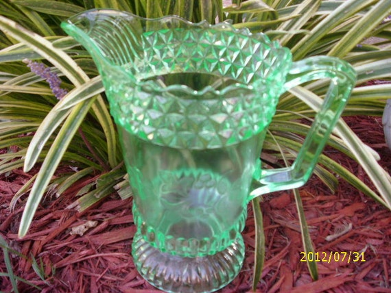 Vintage Green Glass Pitcher with Floral Design