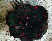 SALE- Black And Green Horror Themed Rose Embellished With A Hand Painted Skeleton Hand
