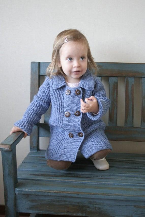 Abrigo de niña tejido a mano. 100% lana azul. 12-18 meses