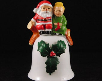 Porcelain bell Santa Claus and Mrs. Claus