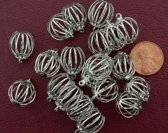 eighteen 15mm round silver tone wire cages