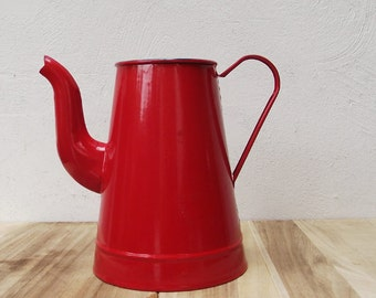 Vintage enamel farmhouse pitcher in a lovely bright red color