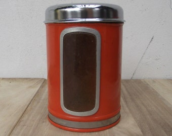 Vintage 1970s Metal orange canister with shiny chrome lid and plastic transparent window