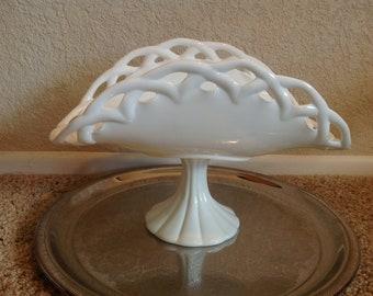 Vintage milk glass pedestal bowl with lacy edge.