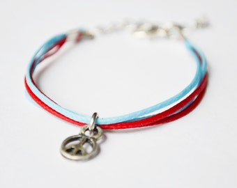 Child's bracelet, children's charm bracelet , silver peace charm bracelet for kids with a blue and red cords Kids jewelry, gift for children