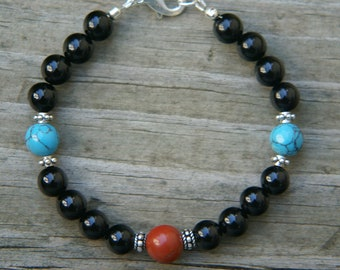 Black Onyx bracelet with Turquoise and Red Jasper accent beads