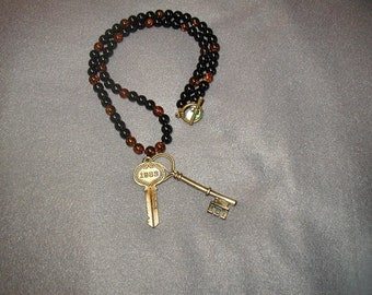 Beaded necklace with keys