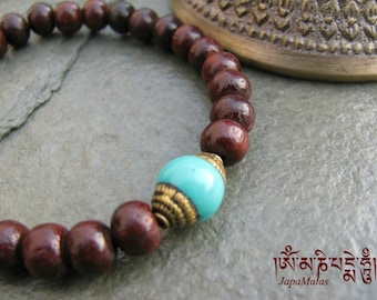 Rosewood Bracelet Mala with capped turquoise guru bead purified & blessed mala