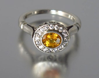 THE SECRET DELIGHT 14k gold Yellow Sapphire engagement ring with diamond halo