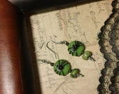 Arachnid - spooky green glass and serpentine spider natural stone earrings