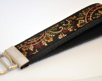 Earth Toned Black, Rust, Olive and Tan Paisley Fabric Wristlet Keychain