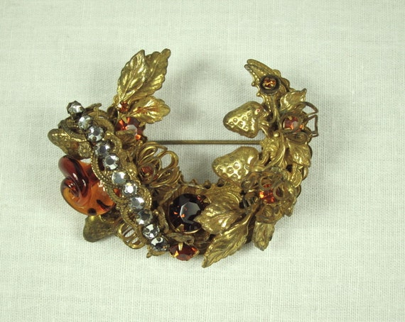 ... similar to Vintage MIRIAM HASKELL Amber Crescent Wreath Brooch on Etsy