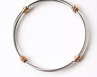 """Ultra modern oxidized silver and solid 14KY gold bracelet, pairing of the dark of the silver and yellow gold - """"Gold Bundle Hoop Bracelet"""""""