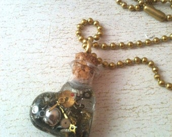 Heart Shaped Bottle Filled with Watch Parts Necklace