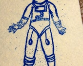 cream colored heavy wool blend felt patch with gocco designed spaceman space man diver