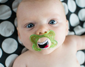 The Comedian Custom Hand Painted on a Green Pacifier by PiquantDesigns