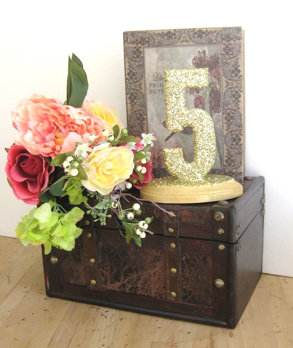 Items similar to gold glittered table numbers wedding