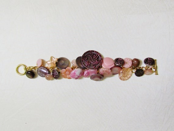 Handmade button bracelet with antique Victorian metal, glass, paperweight, and abalone shell buttons