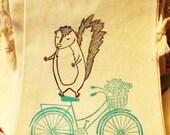 Hand stamped weird skunk on a bike muslin thank you favor bag