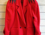 vintage 1980s wool coat in red with black leather accents. retro outerwear.