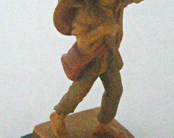 Handcarved Wooden ANRI Figurine of Peasant Boy Eating Grapes From The Vine